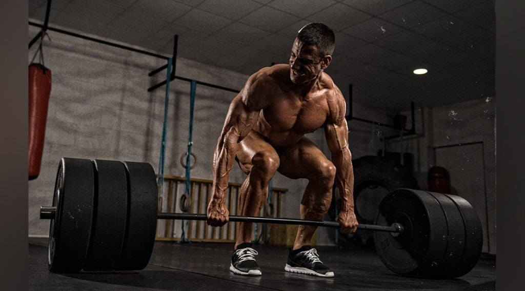 Man exercise heavy weight lifting